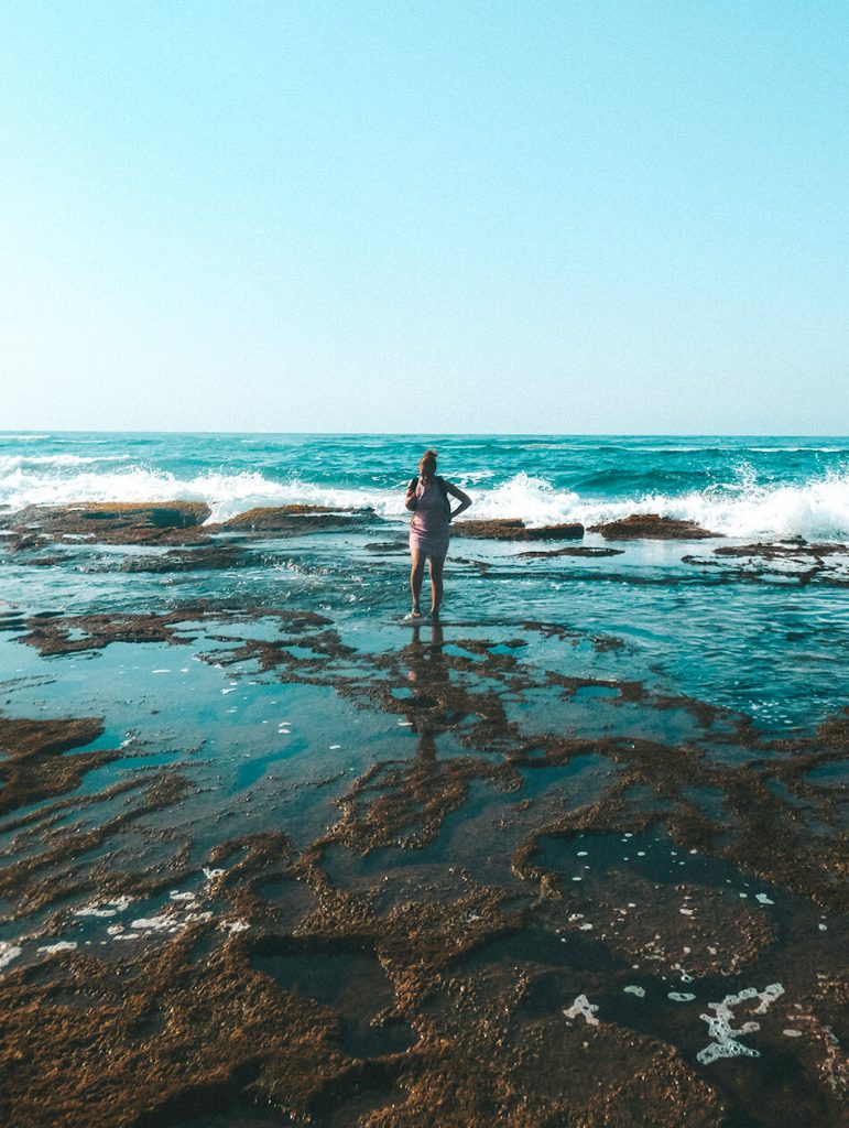 Searching for sealife between the Mission Rock Pools of Isimangaliso Wetland Park in St Lucia, South-Africa