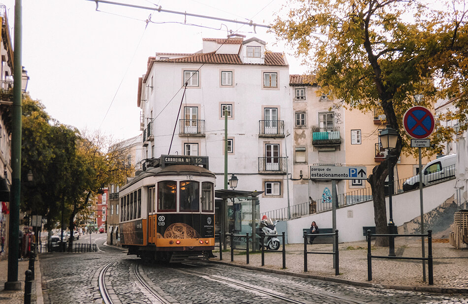 Riding the yelow trams around the Alfama neighbourhood in Lisbon