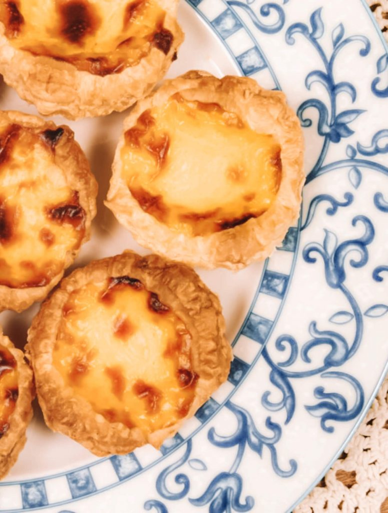 Enjoy deliscious egg tarts with cinnamon in Bélem