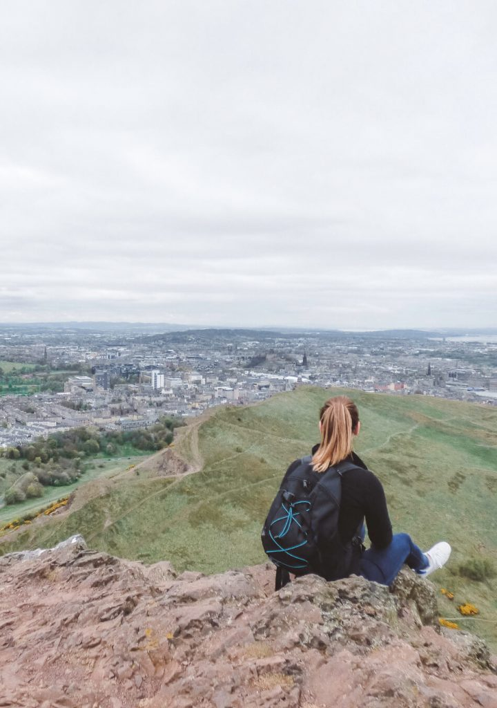 Enjoying the view over Edinburgh at the top of Arthur's Seat