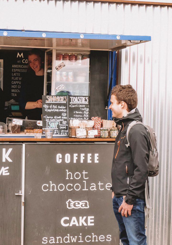 Enjoying some hot cacao while walking through Edinburgh on our  self-guided walking tour