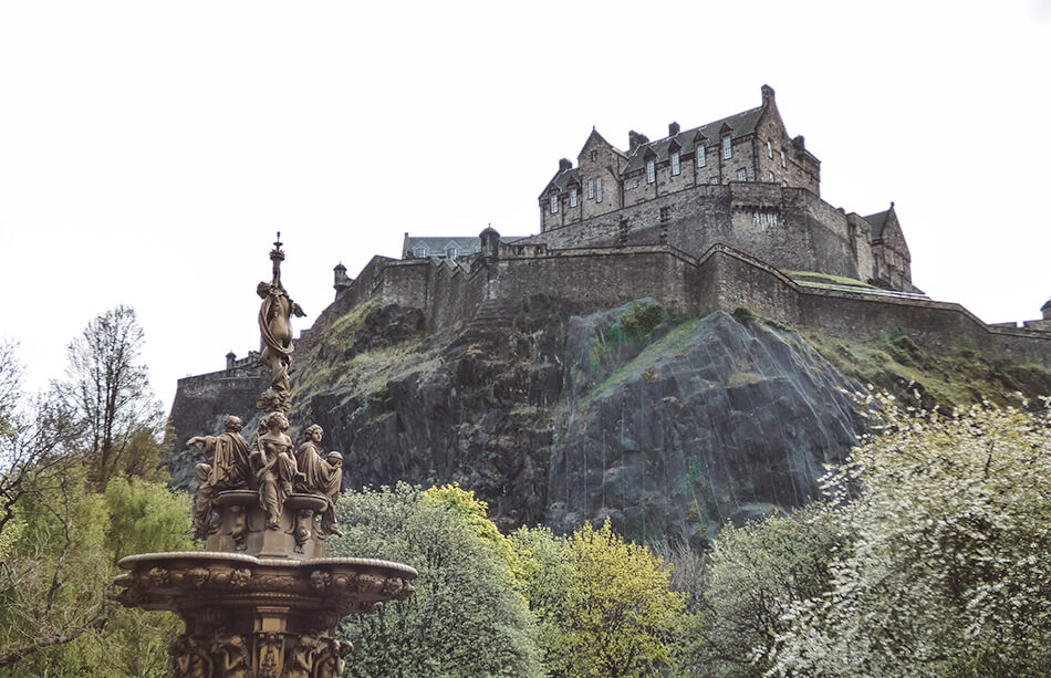 Edinburgh Castle glooming above Princess Street Garden