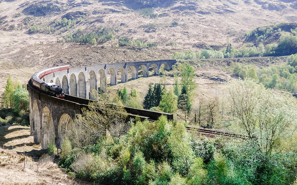 Jacobite Steam Train or Hogwarts Express over the Glenfinnan Viaduct