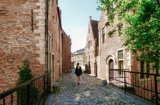Strolling through narrow streets and old buildings in the Grand-Beguinage Leuven, Belgium