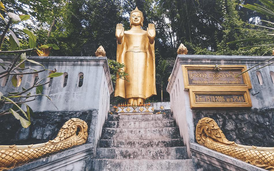Golden statues adorn Phousi Hill in Luang Prabang, Laos