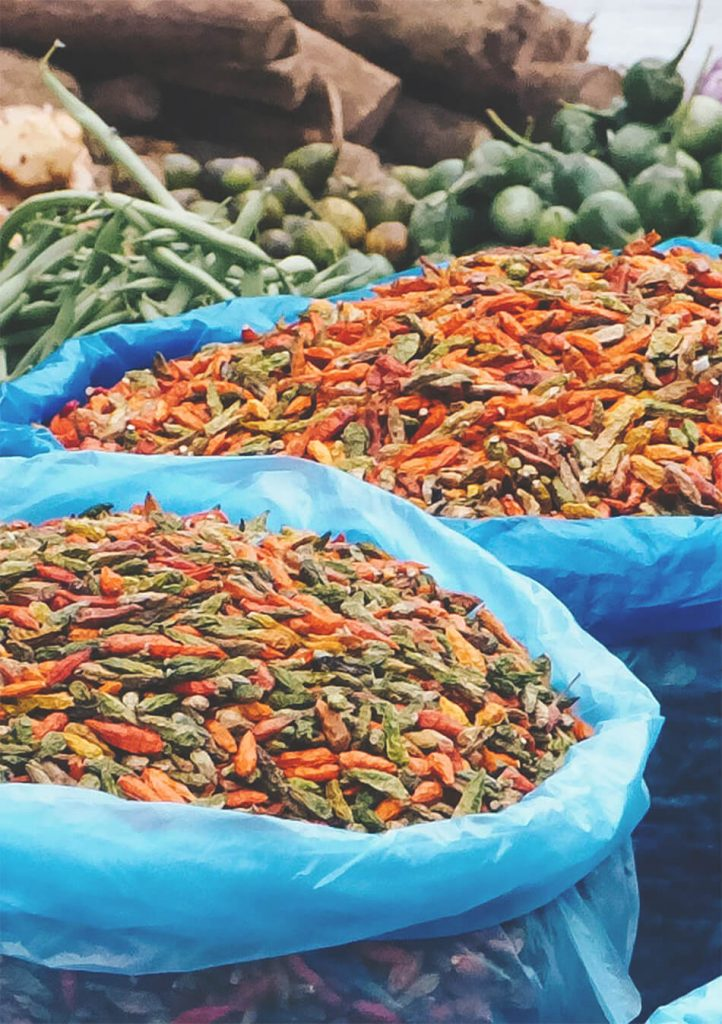 Dried peppers and other foods are being sold at the morning market in Luang Prabang, Laos