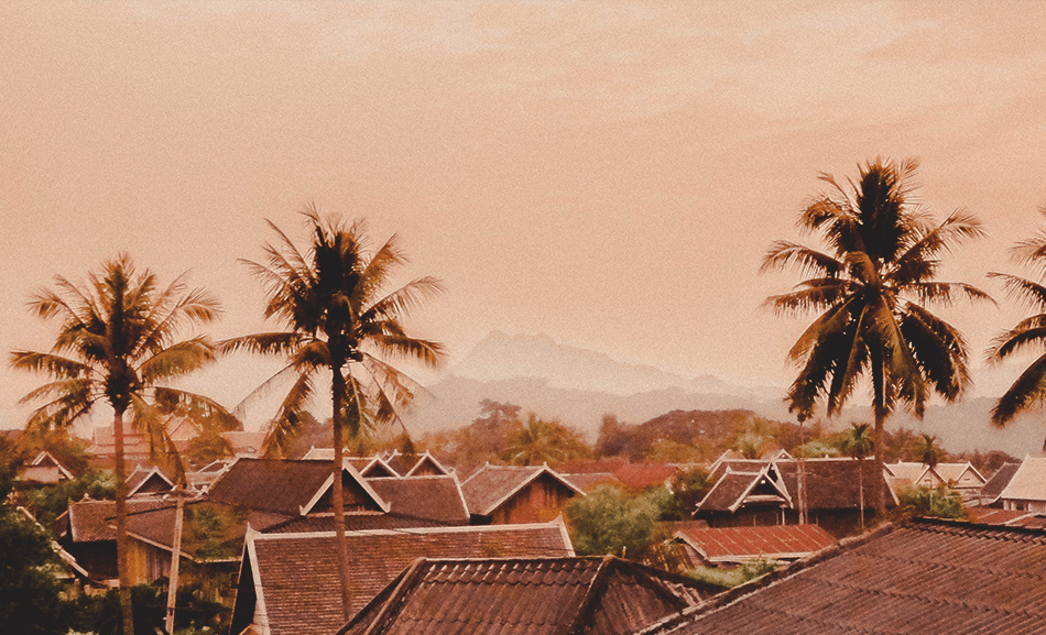 Sunsets turning the Luang Prabang rooftops pink