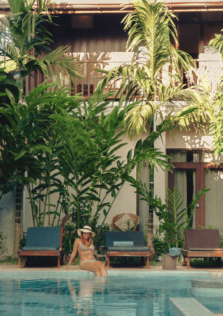 Lounging at the refreshing pool of Maison Dalabua, a serene boutique hotel in Luang Prabang, Laos