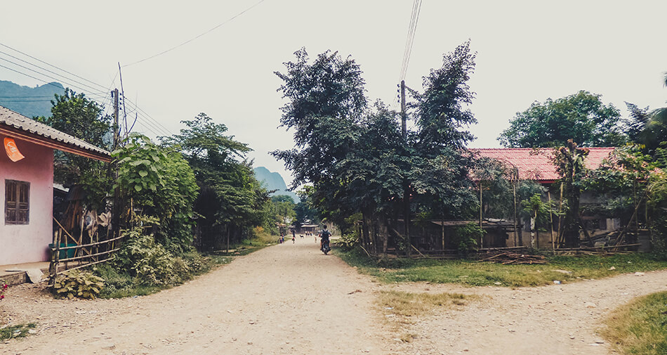 Motorbiking through local villages in Vang Vieng