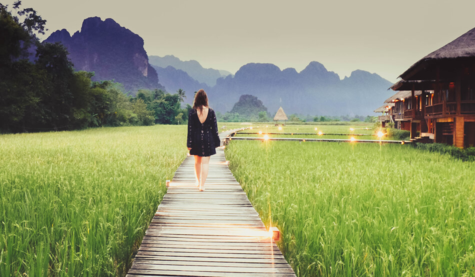 strolling through the rice fields while taking in the limestone rock formations at Vieng Tara Villa at Vang Vieng