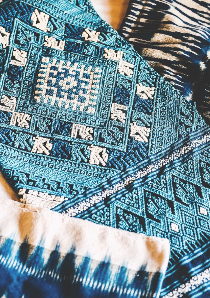 Handmade fabrics painted in indigo colours for sale in Luang Prabang, Laos