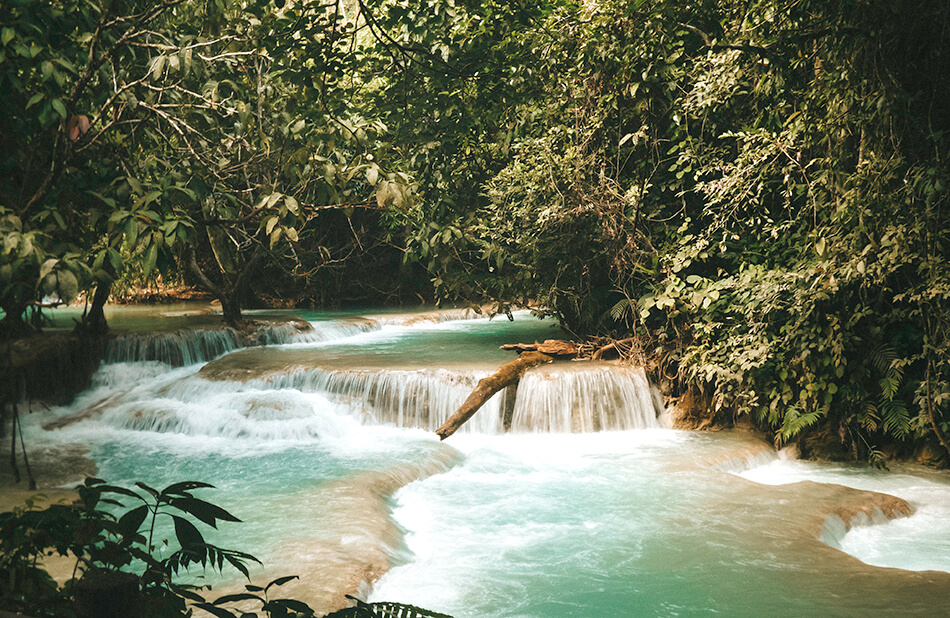 Cascading turquoise pools as far as the eye can see at Kuang-Si Falls