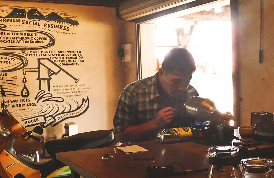 Testing the arabiata coffee at Jhai Coffe shop, the Bolaven Plateau