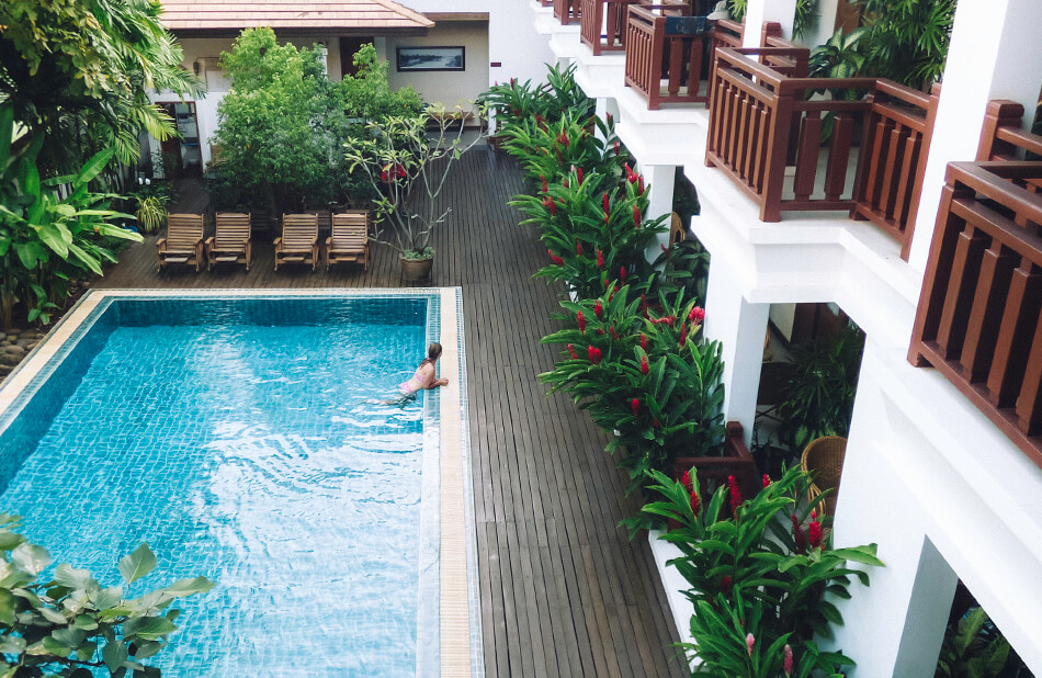 Washing off the dirt and heat in the pool of Athena Hotel Pakse