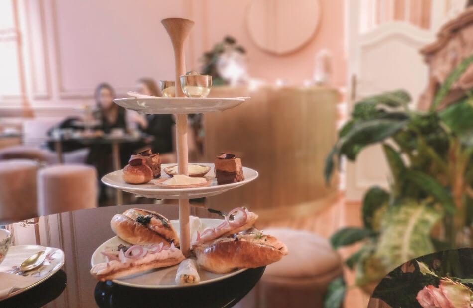 Enjoying high tea in a powder pink decor in Antwerp