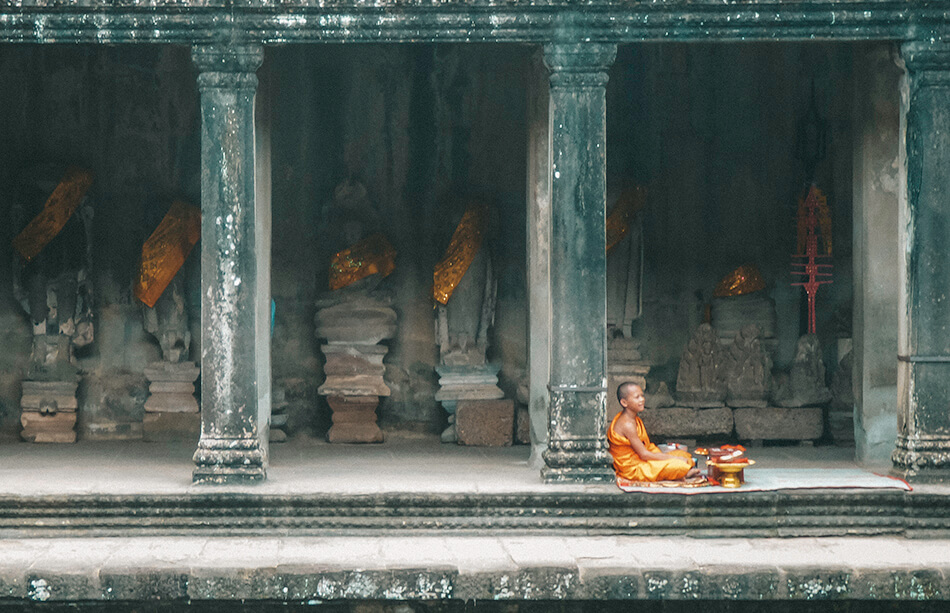 Monk inside the Angkor Wat temple
