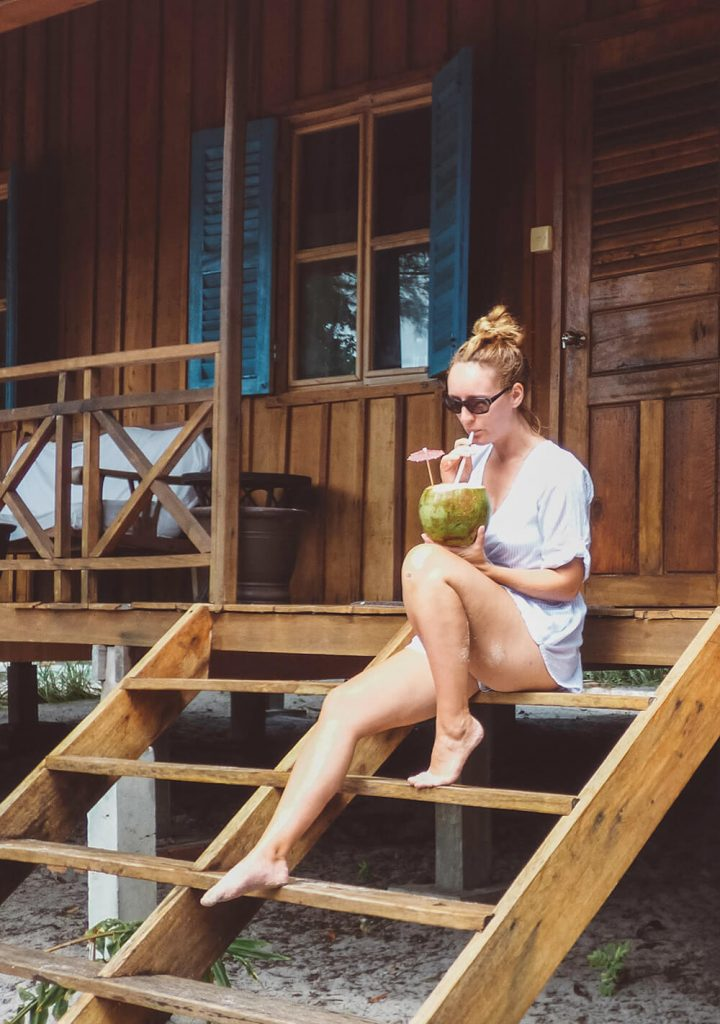 Sippin a coconut on the porch of our bungalow at Sok San Beach Resort