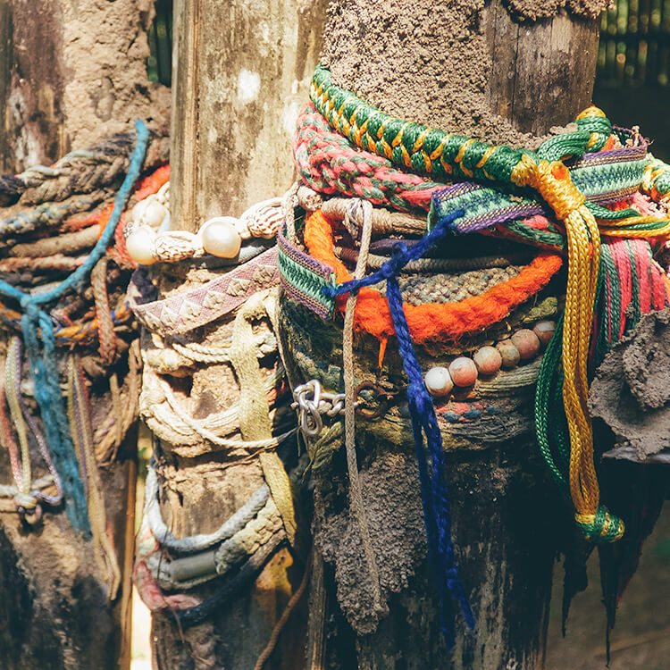 Colourful bracelets decorate the shrines at the Killing Fields in Phnom Penh, Cambodia