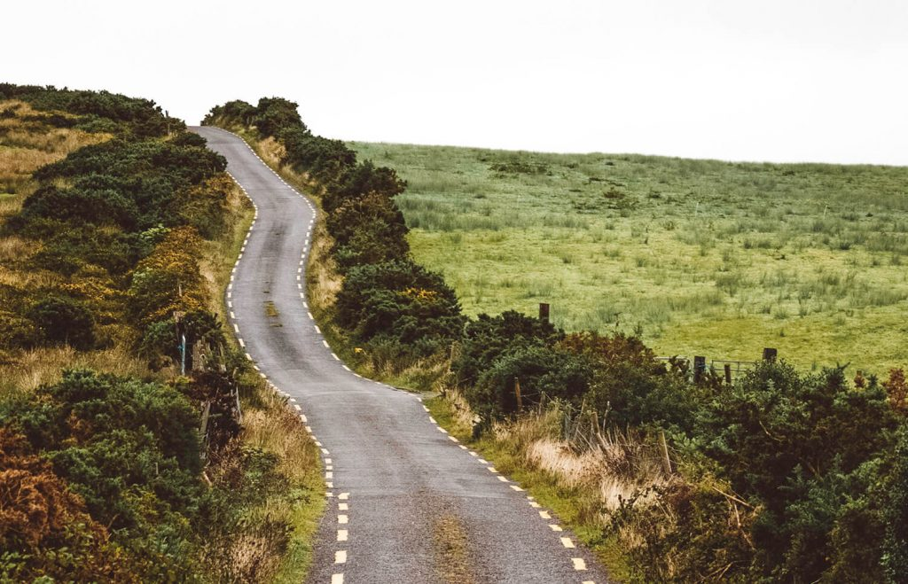 These narrow winding roads are frequent when driving in Ireland