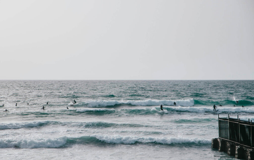 Surfers on the Tel Avivian coast - an excellent authentic Israeli experience