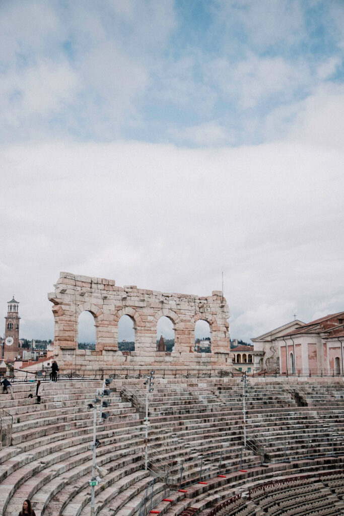 Inside the Verona Arena admiring remnants of the outer arena wall