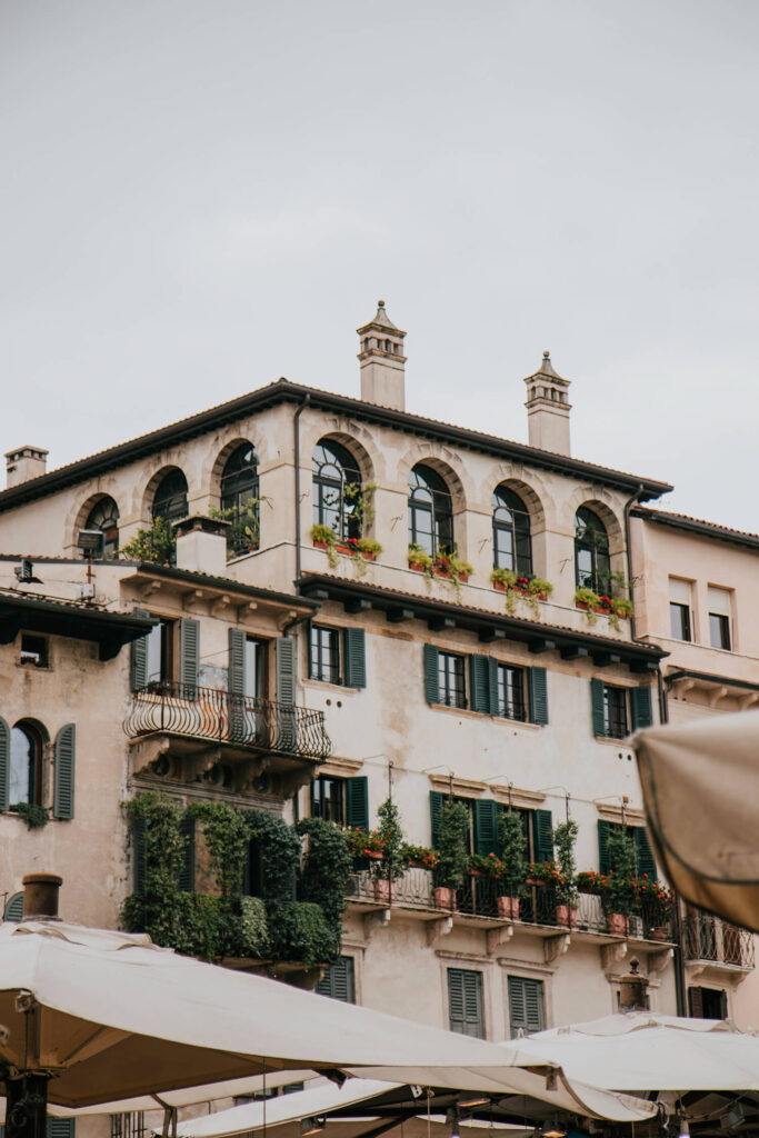Beautiful houses with balconies surrounding Piazza delle Erbe