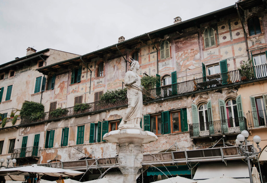 Beautiful houses and fountain at Piazza delle Erbe