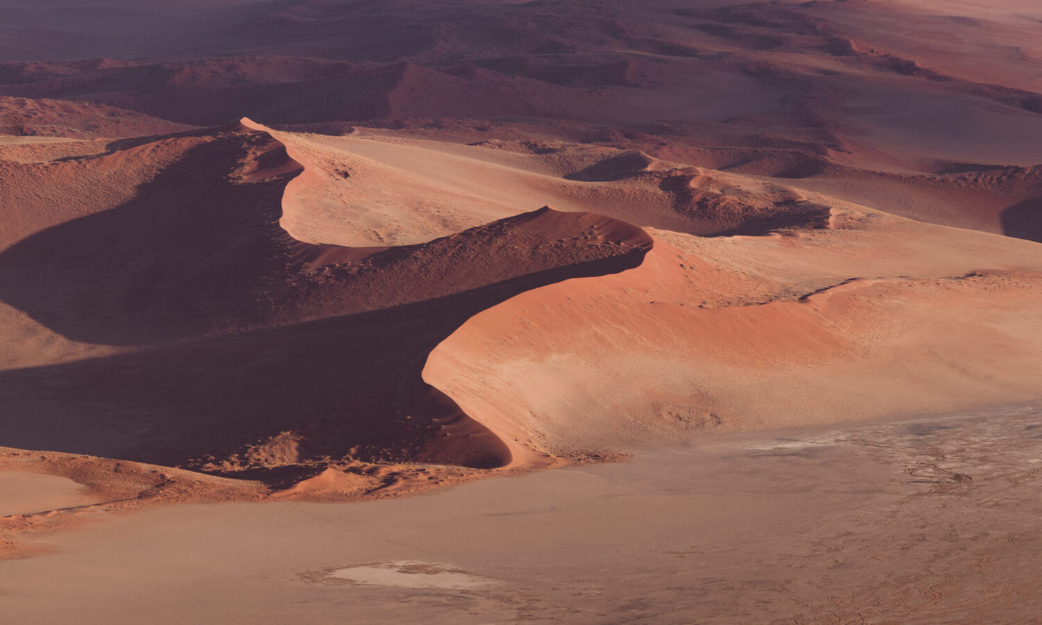 The Namib dune ridges look like dragon spines while viewing from a hot air balloon above the Sossusvlei