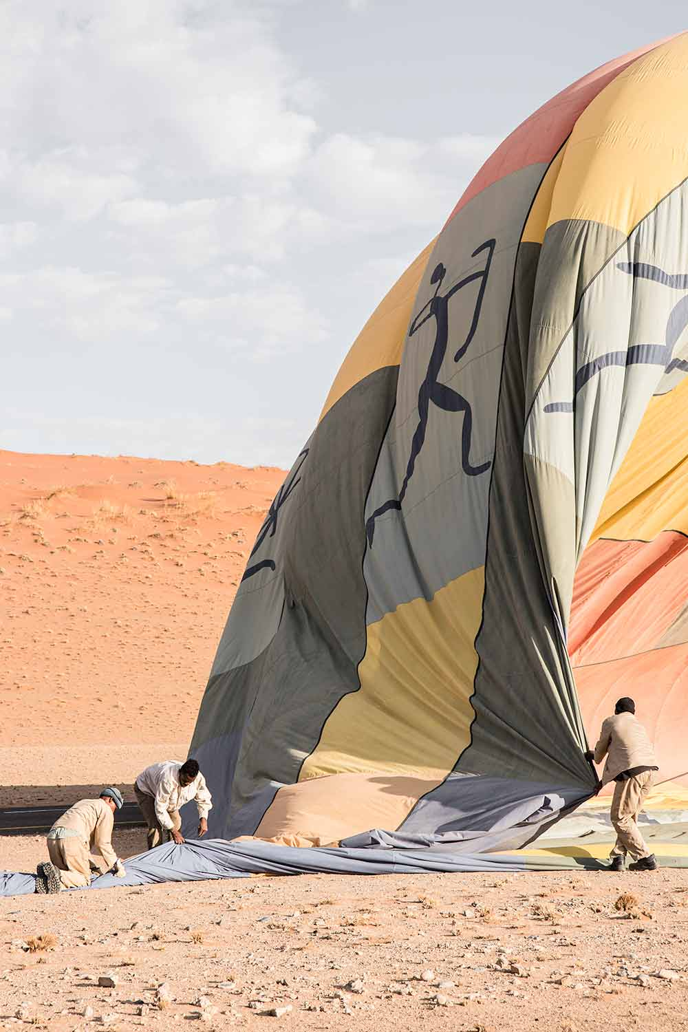 Packing up the air balloon after enjoying a one hour scenic flight over the Sossusvlei dunes.