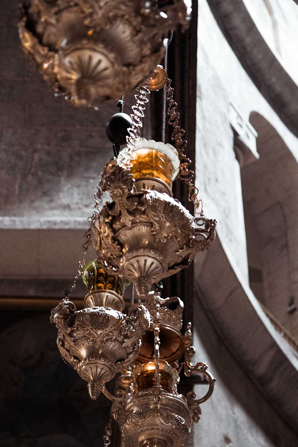 Dangling lights at the Church of the Holy Sepulchre in the Christian Quarter of Jerusalem