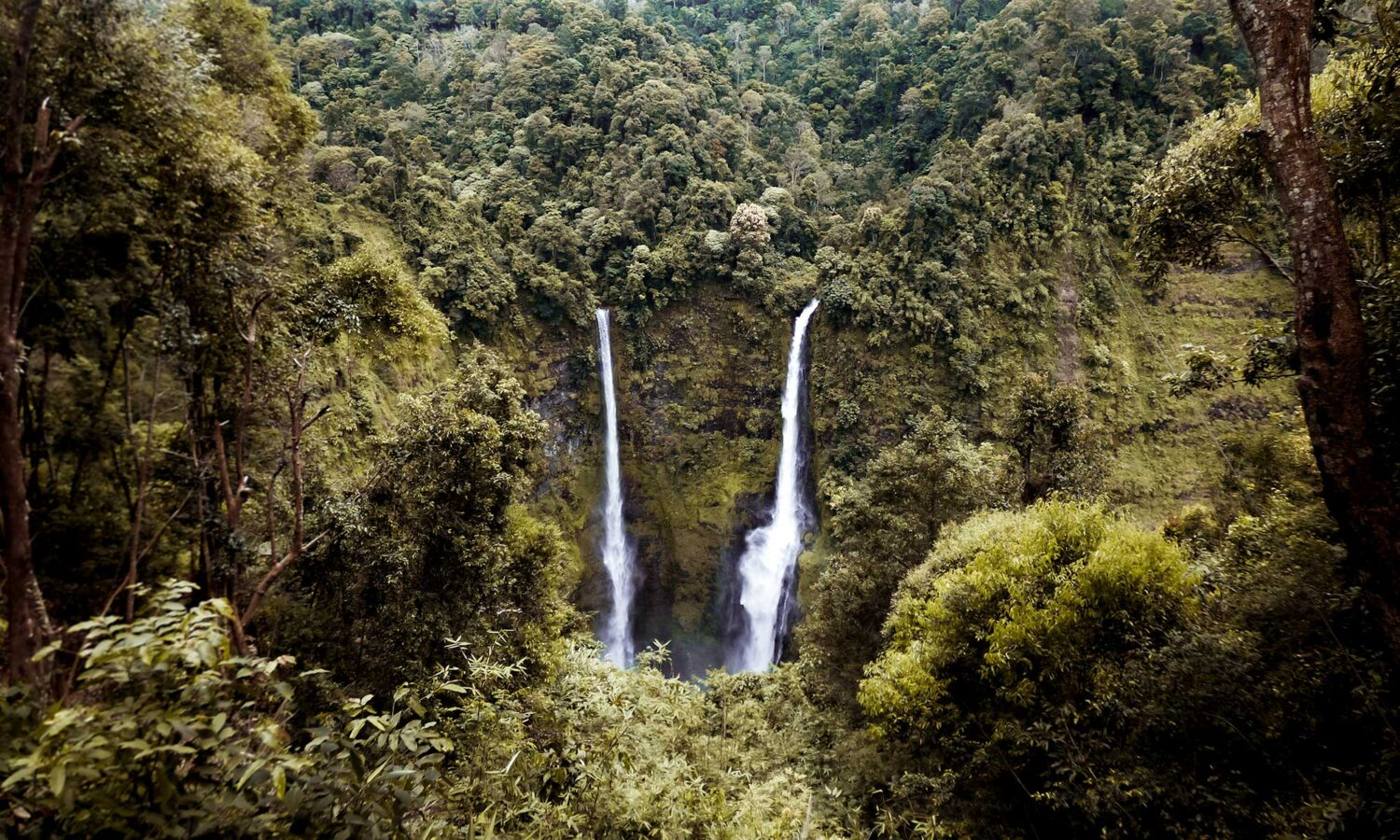 Tropical waterfalls peppered around the volcanic landscape of the Bolaven Plateau