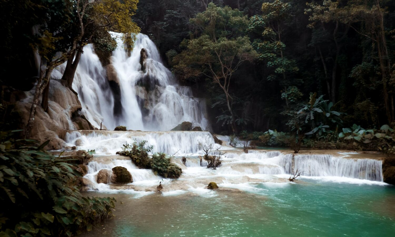 Turquoise blue pools at Kuang Si Falls, just outside Luang Prabang