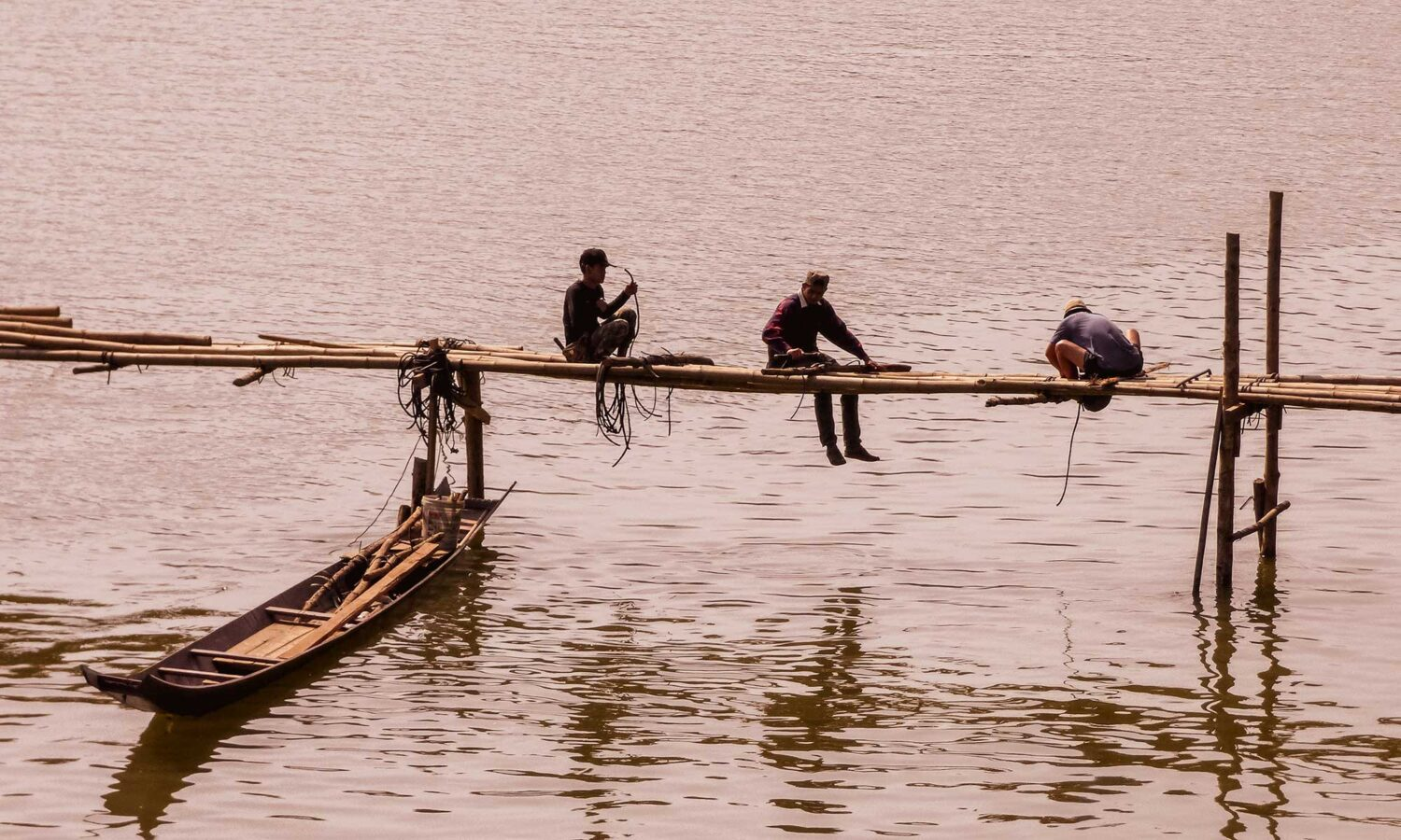 Local men building a bamboo bridge over the mighty Mekong River in Luang Prabang
