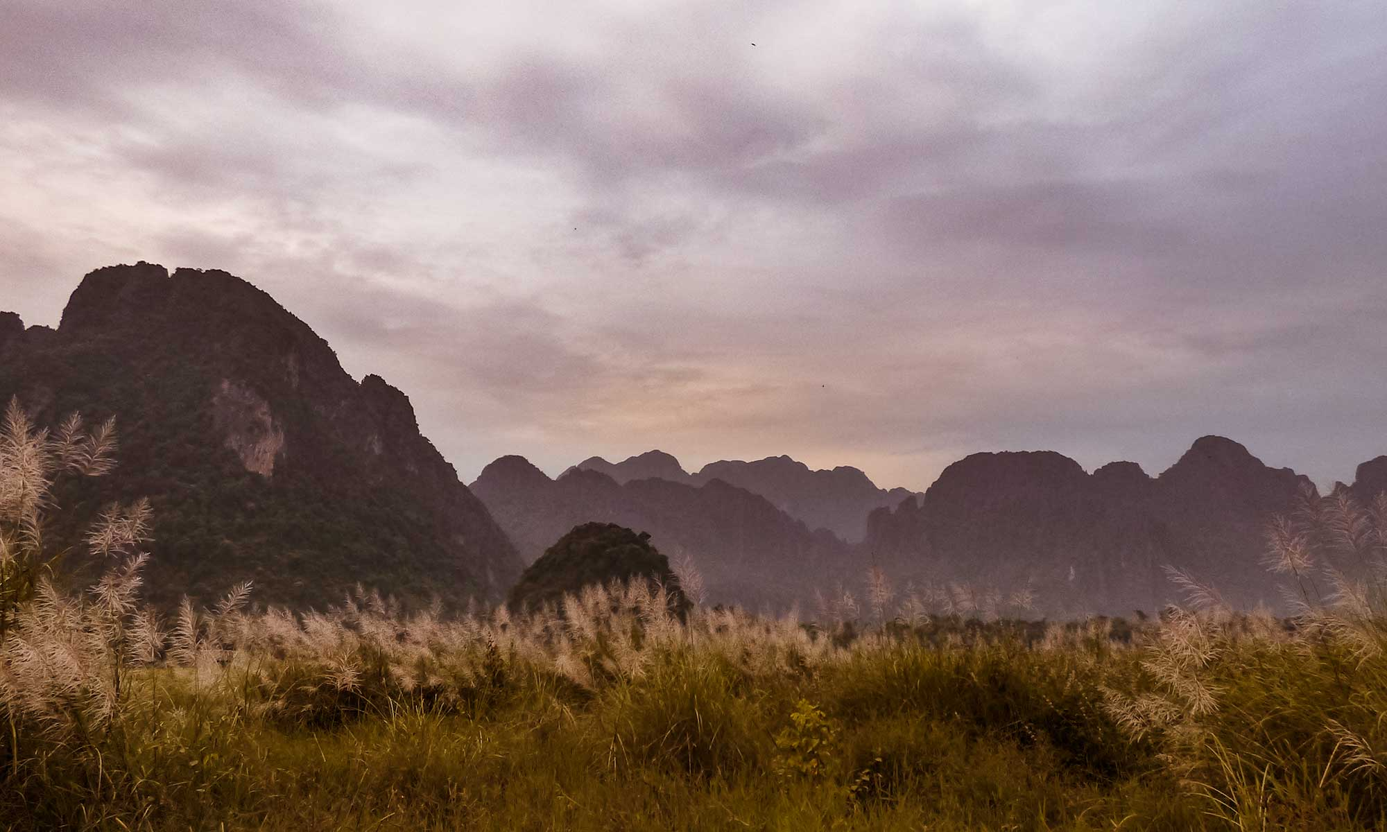 Sunset veins over Vang Vieng limestone cliffs, one of the best places to visit in Laos to admire the sunset