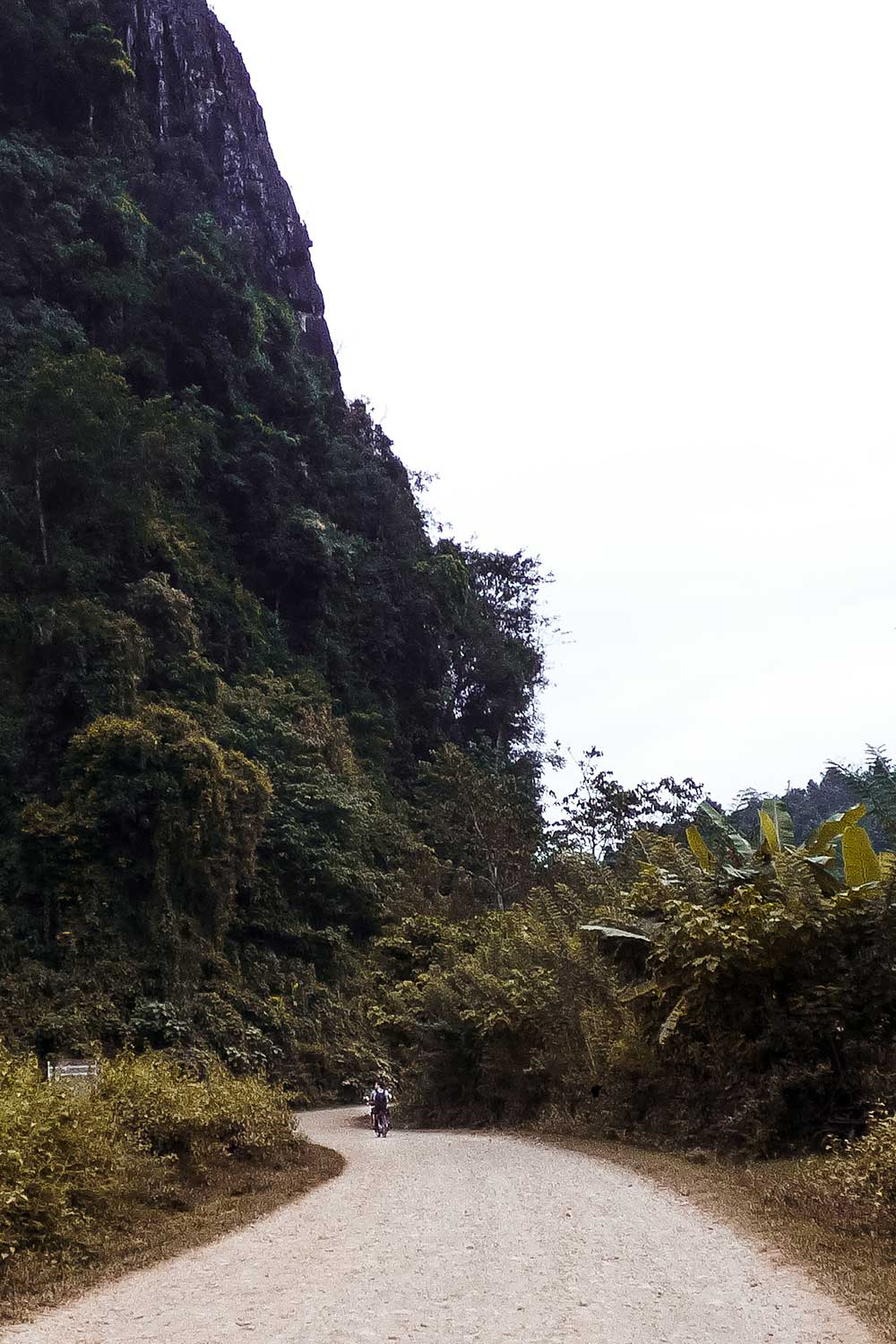Feeling incredibly small when riding past Vang Vieng's limestone mountains