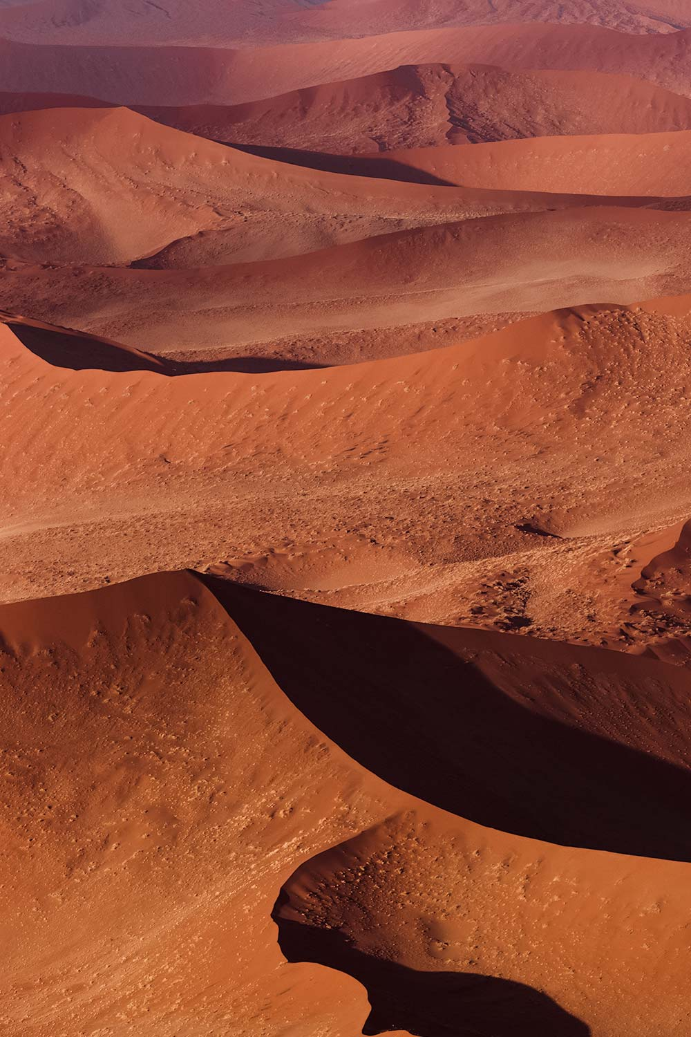 The most romantic of all Sossusvlei activities is admiring the abstract sand shapes of the dunes below.